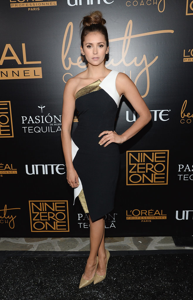 It was black, white, and gold for Nina at the Nine Zero One salon launch party, where she stepped out in an Andrew Gn dress and Jimmy Choo heels.