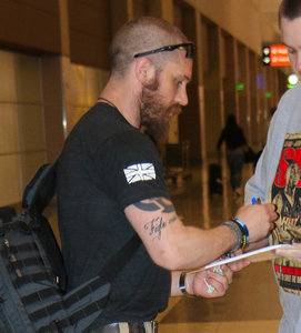 Tom Hardy and Nicholas Hoult arrive in Las Vegas