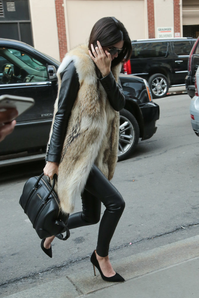 Kendall Jenner gave off a sophisticated vibe with her all-black ensemble, long fur coat, and Givenchy Antigona bag.