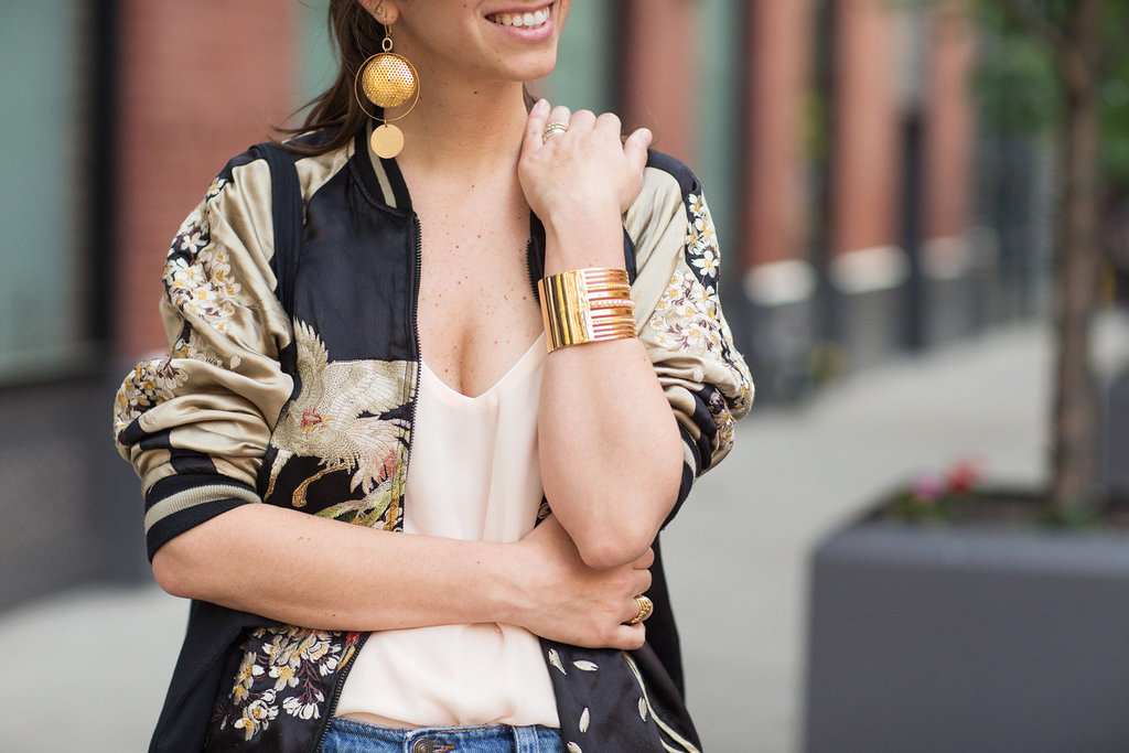 A patterned gold jacket paired with shining accessories capture the warm glow of Summer's long days.