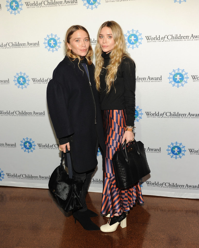 Twinning combo: The high-style sisters showed minimal skin while attending the World of Children Awards in 2014.  Ashley, in an unusual move for the usually monochromatic dresser, went bold in a funky striped skirt. Mary-Kate pumped up the volume in a cocoon coat.