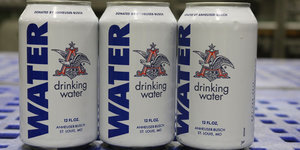 Anheuser-Busch Stops Brewing Beer To Produce Cans of Water For Flood Victims