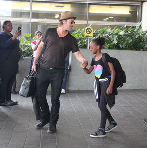 Brad Pitt and Angelina Jolie arrive in Los Angeles with their children