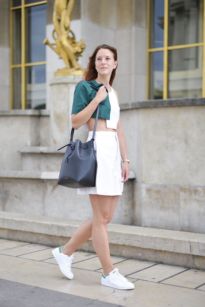 Anna Kraft topped off a warm-weather outfit with on-trend Adidas sneakers and a Mansur Gavirel bucket bag.