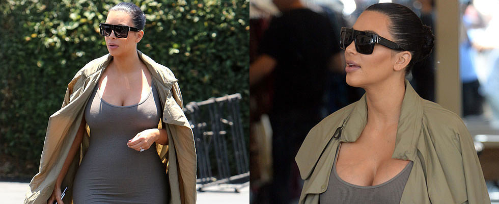 Kim Kardashian Shows Off Her Baby Bump in a Skin-Tight Maxi Dress