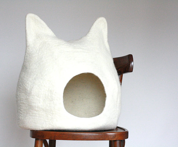 This cat bed ($109) is like a fantastic mashup of Where the Wild Things Are and a cat. We love the ears!