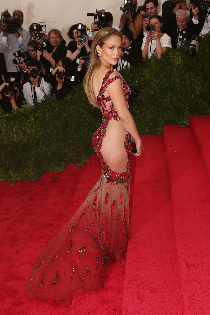 "On the Met Gala red carpet in 2015, Jennifer gave us quite an eye-full in a fiery, embellished Versace gown we quickly dubbed ""the naked dress."""