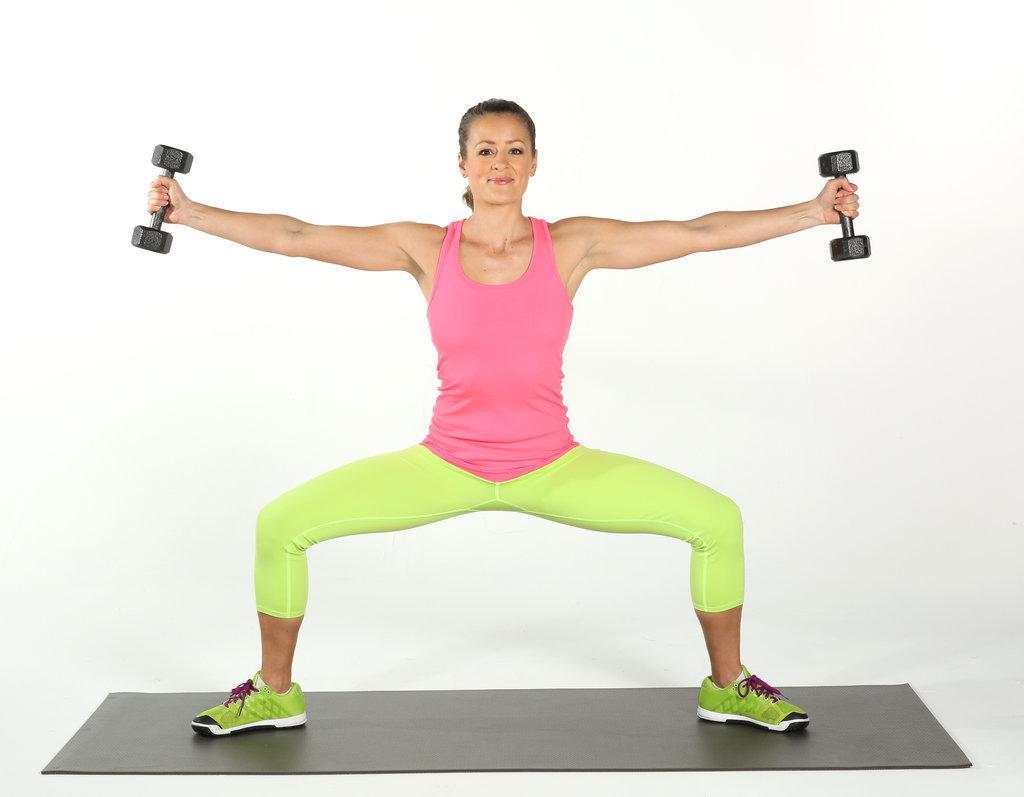 Sumo Squat With Arm Raises