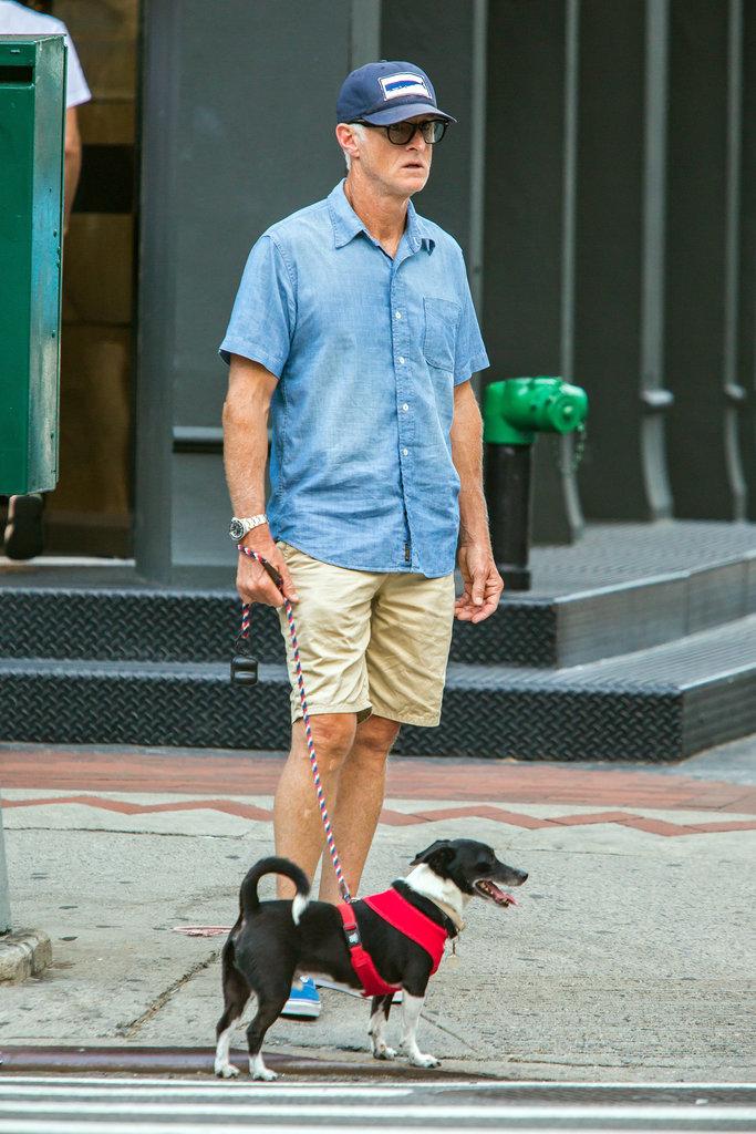 John Slattery walked his canine companion around NYC in July 2015.