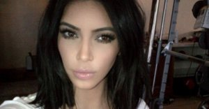 Kim Kardashian Says Body Shaming Is The Reason She Doesn't Smile
