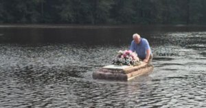 South Carolina Pastor Defies Cop's Orders, Saves Casket Drifting Away In Flood