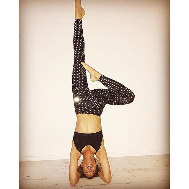 Bar Refaeli is testing out her Nike glow-in-the-dark leggings by doing this headstand variation.