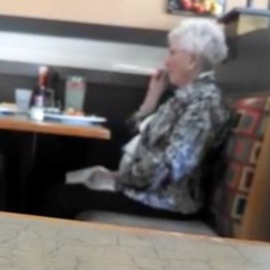 Elderly Couple Shooting Straws at Each Other