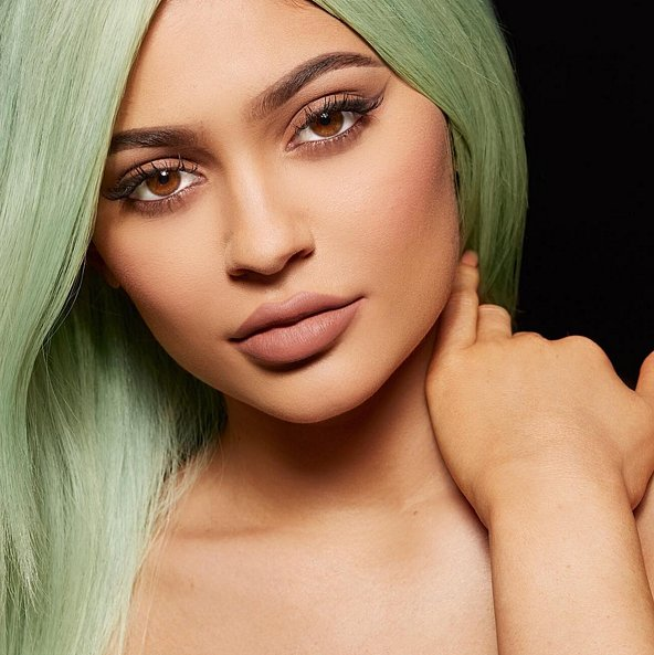 kylie jenner posing for lip kits by kylie review