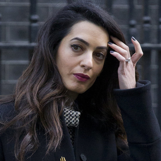 Amal Clooney Wearing a Black Coat With Gold Buttons