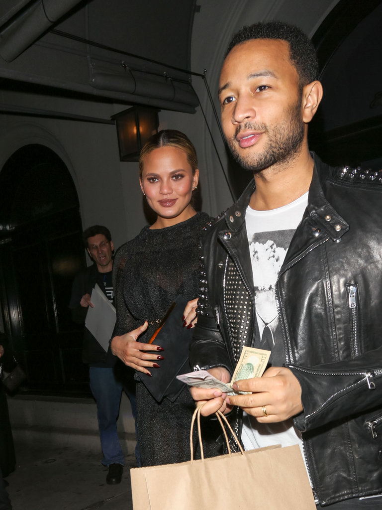 Chrissy contrasted John Legend's edgy style — he opted for a graphic t-shirt and studded leather jacket.