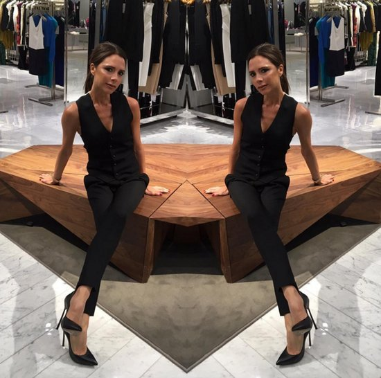 Victoria Beckham Wearing Black Vest and Pants 2016