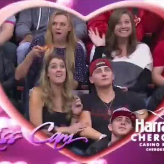 Woman Eats Pizza on Kiss Cam