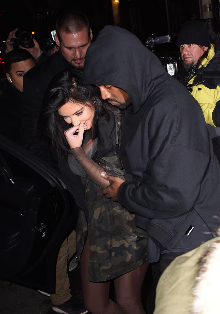 Kanye showed off his courtly manners during a low-key NYC outing with Kim in Feburary 2015.