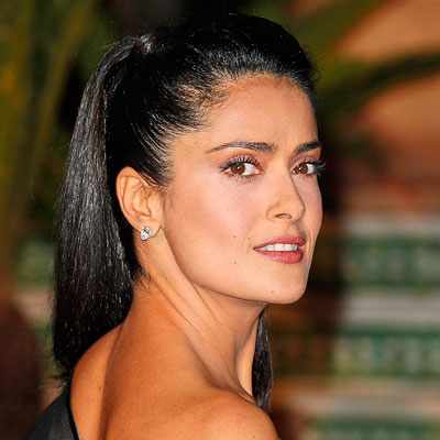 THE STYLE An extra-high and extra-glossy long ponytail Salma Hayek'sponytail has a glamorous, '70s feel—give yours an '09 edge by keeping it a tad loose around the crown and wrapping a strand of hair around the band that holds it in place.