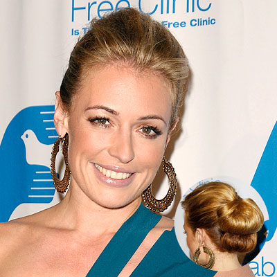 THE STYLE Two loopy buns piled one on top of the other  Cat Deeley has such pretty, wavy hair (and tons of it!) that it's no surprise we usually spot her with it down. This innovative updo is surprisingly easy to execute: Gather your hair into a half-back ponytail, tuck it under, and secure the loop with pins. Then repeat with the hair that's still do