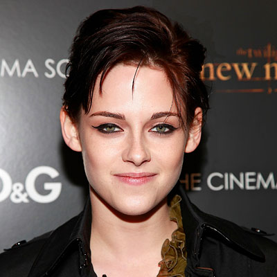 THE STYLE A casual updo with textured, crested bangs  Kristin Stewart's edgy style isn't conventional, and that's exactly why we can't get enough of it. If you've got short hair at an in-between length, clip the back strands up with a handful of pins. Then work a dab of gel between your palms and finger-style the hair around your face. But don't be timid—confidence is a key component for working this look.