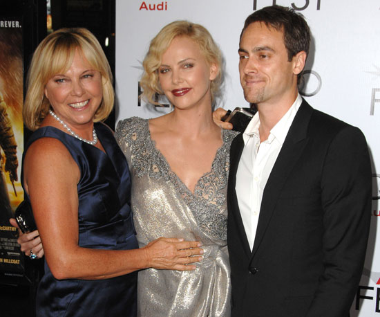 Slide Photo of Charlize Theron with mom Gerda and Stuart Townsend