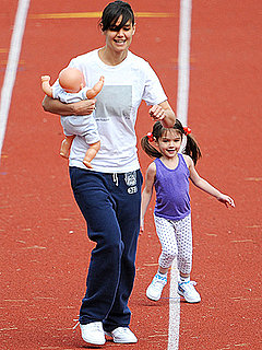 Katie Holmes and Suri Running On a Track
