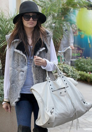 Nicole Richie Holiday Shopping at The Grove in LA in Fur Vest and Big White Balenciaga Bag