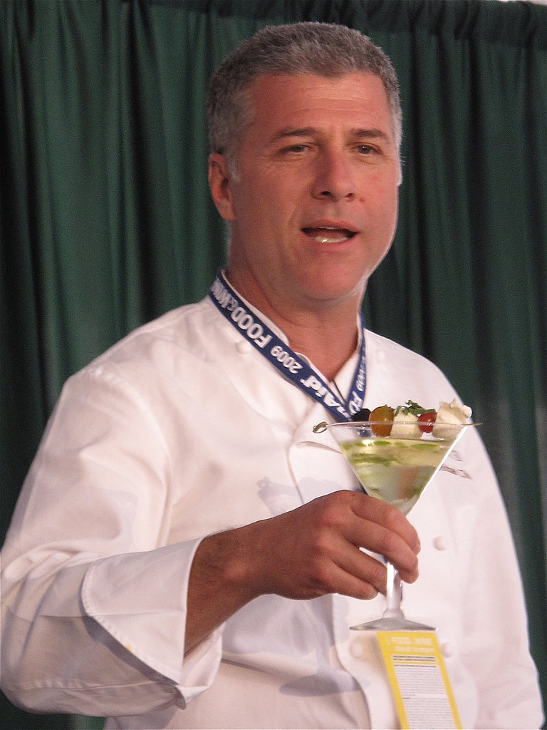 Michael Chiarello toasts with a fresh tomato water martini, topped with tomatoes and fresh mozzarella.