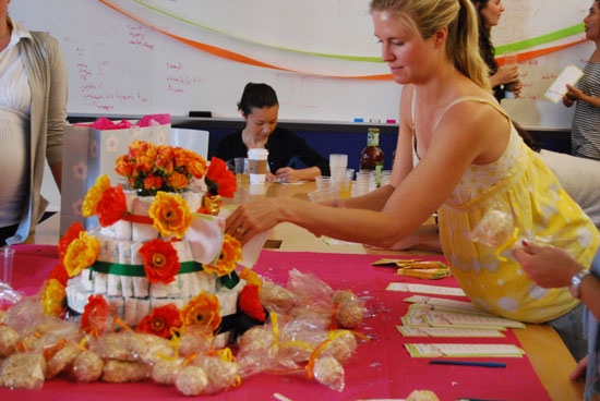 Stuffing the Diaper Cake With the Wishes