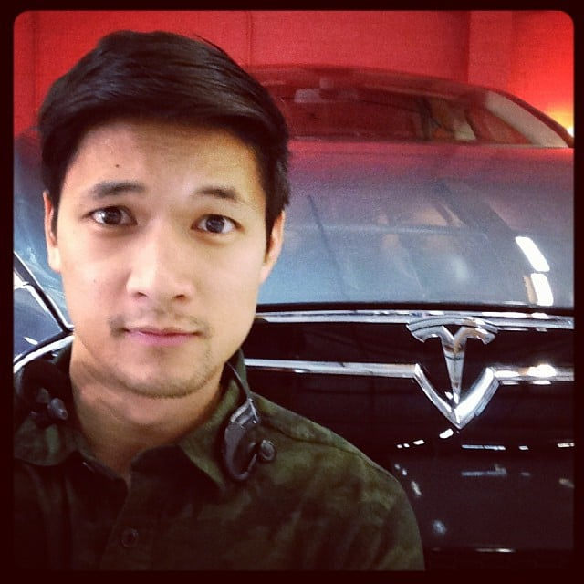 """Harry Shum Jr. posted a photo while getting """"photobombed by a wild grey Tesla."""" Source: Instagram user harryshum"""