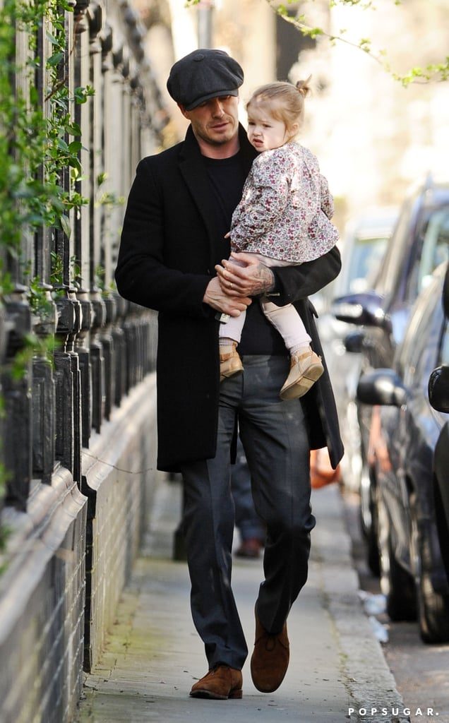 David Beckham carried Harper through Notting Hill in London.