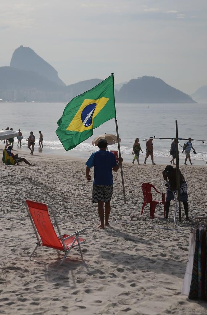 A man carried his Brazilian flag along the beach in Rio de Janeiro.