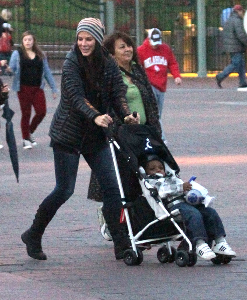 Sandra Bullock had fun pushing Louis around Disneyland.