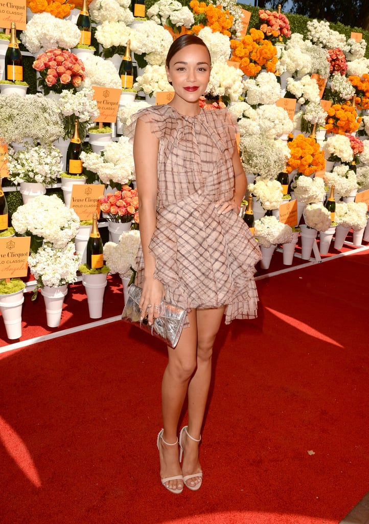Ashley Madekwe was undeniably flirty in her frothy Zimmermann dress, white ankle-strap sandals, and metallic Jimmy Choo clutch at the Veuve Clicquot Polo Classic.