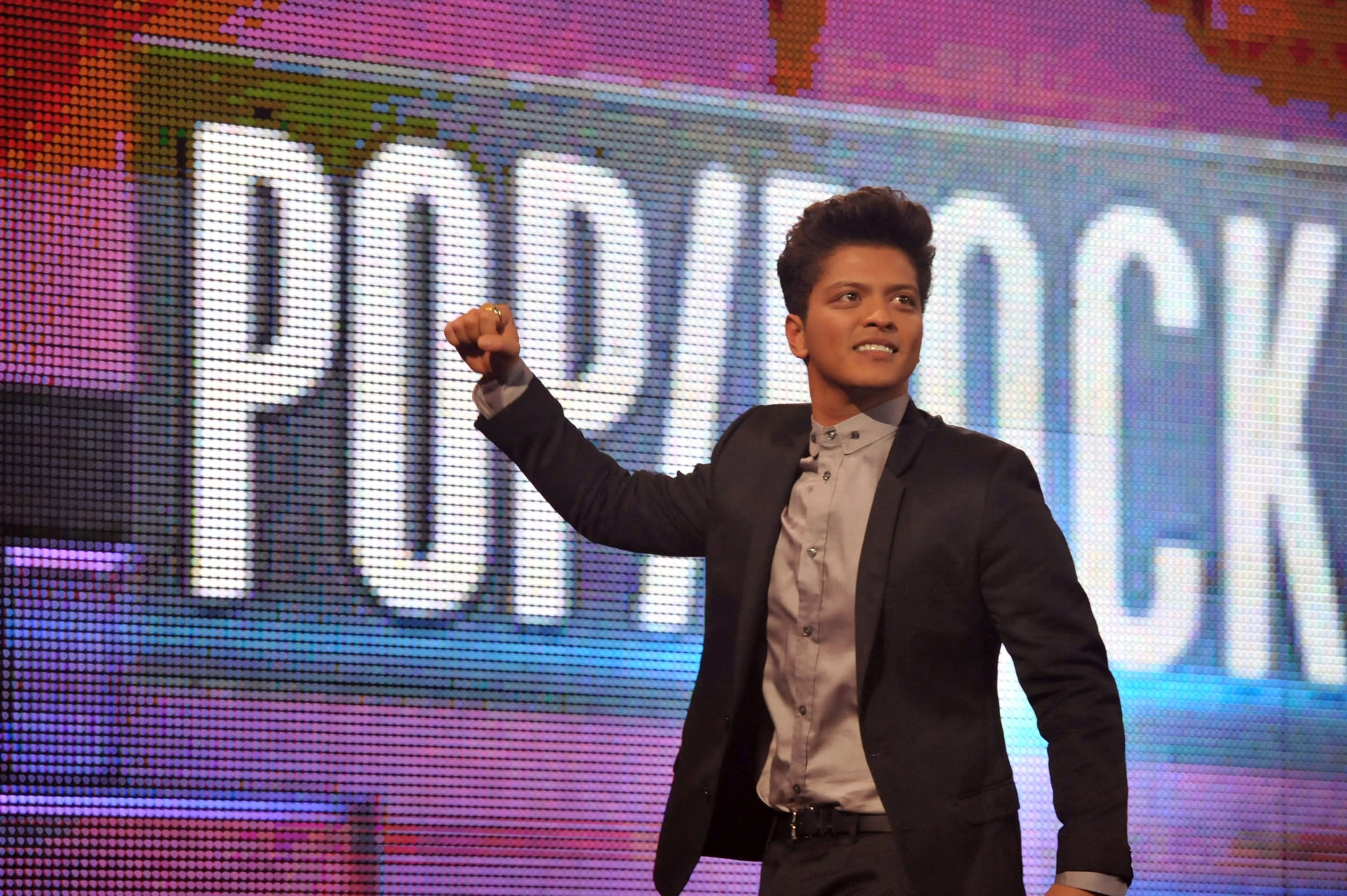 Bruno Mars put his fist in the air.