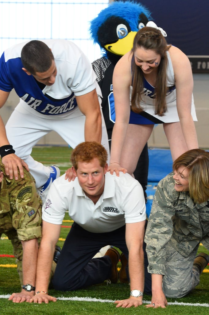 All eyes were on Harry while he participated in a human pyramid in Colorado Springs.