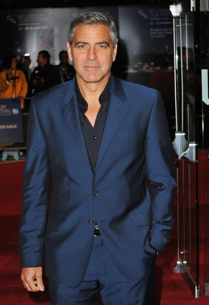 George Clooney in a blue suit for The Ides of March premiere in London.