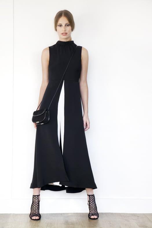 Jumpsuit Dress in Two-Toned Silk in Black & Cream ($1,295), Scandal Suede Sandal Bootie in Black ($895), Treasure Suede Cross Body Bag in Black ($650) Photo courtesy of Tamara Mellon