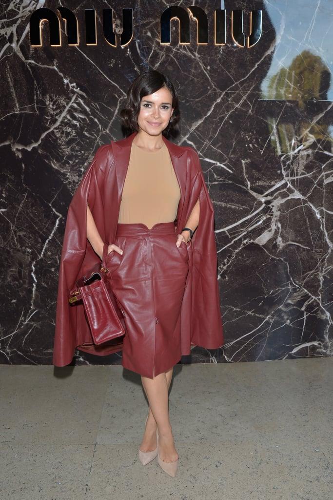 Miroslava Duma was red hot in burgundy leather for the Miu Miu Paris Fashion Week runway.