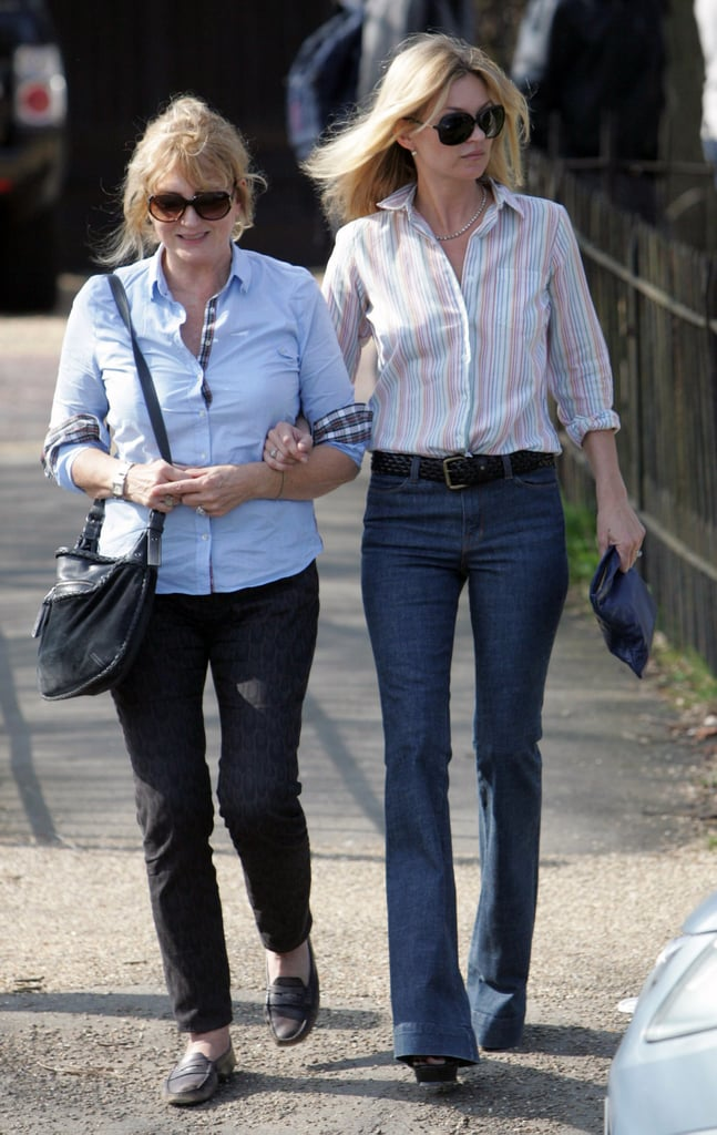 Kate Moss polished up her high-waisted flares while out and about with her mom, with a striped button-down and an oversized clutch for a subtle '70s vibe.