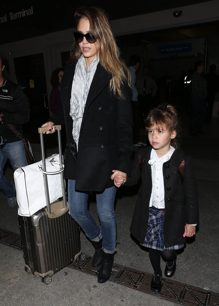 On her way back from Paris, Jessica went black-on-black in a polished peplum coat and Rag & Bone ankle boots after touching down at LAX.