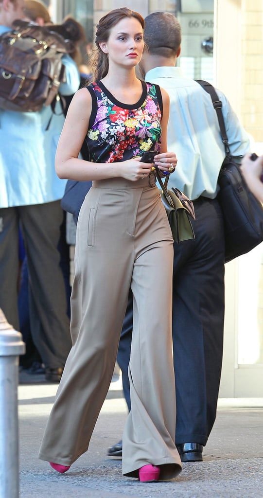Leighton wore a Dolce and Gabbana top, high-waist trousers, Sergio Rossi shoes, and carried a Valentino purse.