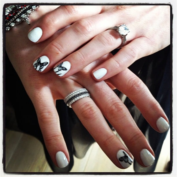 Anne Hathaway's SAG Award nails were done by Tom Bachik and were adorned with little butterflies. Source: Instagram user tombachik