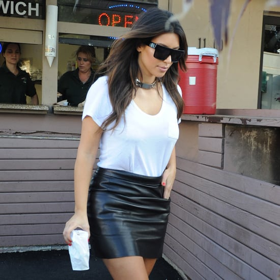 Kim Kardashian Wearing Black Leather Skirt and White Tee