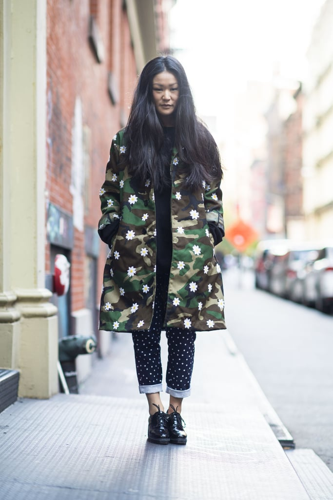 Layers don't mean you have to cover up your style — a bold camo-print coat is the perfect way to show it off.  Source: Le 21ème | Adam Katz Sinding