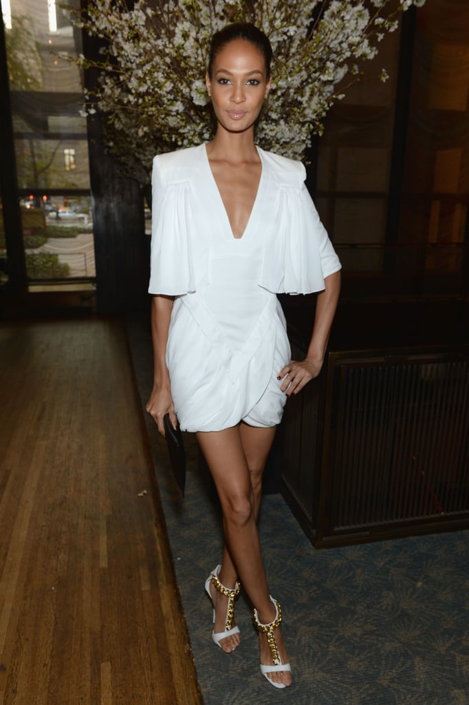 Joan Smalls gave a nod to a Grecian style in her little white plunging dress and chain-detailed sandals at an event in NYC.
