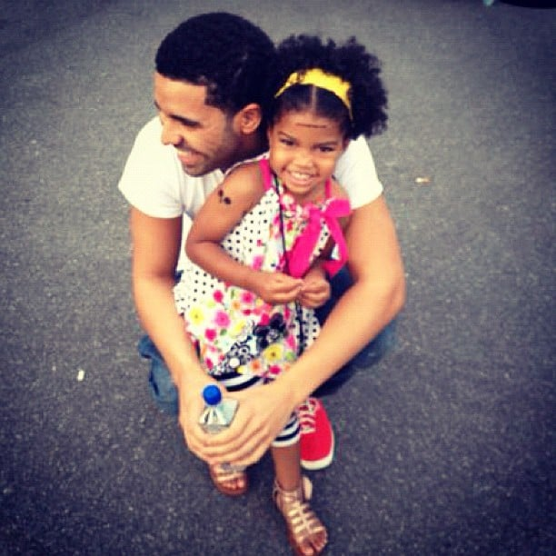 Drake posed with a pint-sized fan.  Source: Instagram user champagnepapi