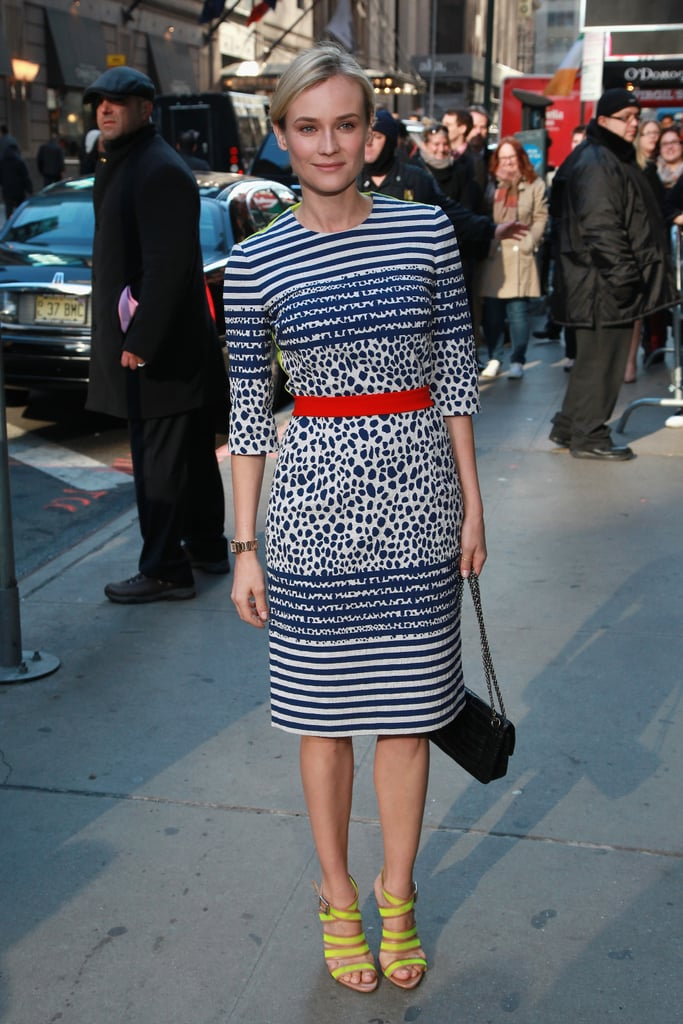 Diane Kruger continued her style tour while promoting The Host in a striped and printed Preen sheath dress.